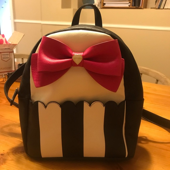 054c13bbd36 Betsey Johnson Handbags - A black and white striped backpack with pink bow